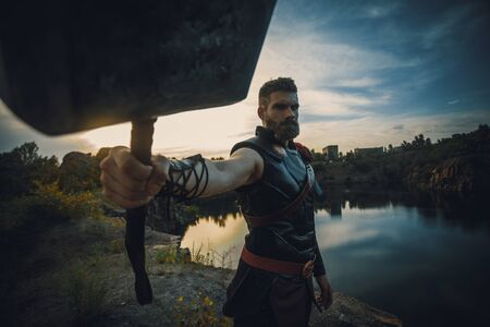Dnipro, Ukraine- June 5, 2019: Cosplayer with hummer in his hand portrays superhero Thor from Marvel Comics.