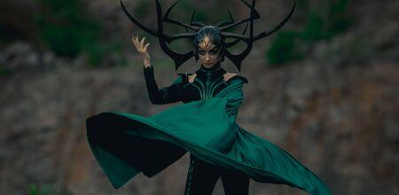 Dnipro, Ukraine- June 5, 2019: Cosplayer portrays death goddess Hela from Marvel Comics. Publikacyjne