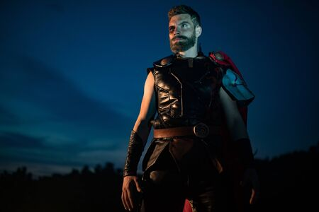 Dnipro, Ukraine- June 5, 2019: Cosplayer portrays superhero Thor from Marvel Comics against background of night sky.