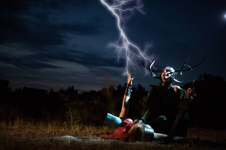 Dnipro, Ukraine- June 5, 2019: Cosplayers portray battle of goddess of death Hela and superhero Thor from Marvel Comics. Publikacyjne