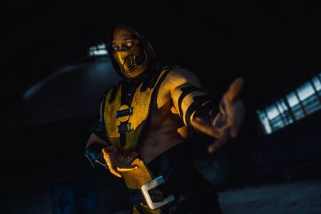 Dnipro, Ukraine - September 29, 2019: Cosplayer portrays Scorpion from the video game Mortal Kombat.