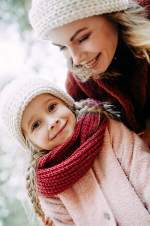 Portrait of happy mother and daughter during stroll.