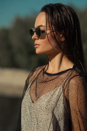 Portrait of young pretty woman in sunglasses outdoor.