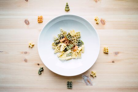 pasta in the form of Christmas decorations on a plate