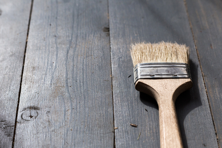 home repairs: paint brush for home repairs on wooden floor
