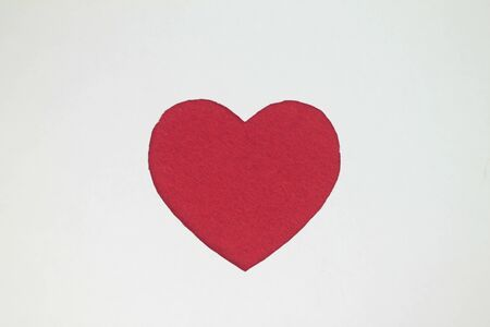 Red heart shaped slot in craft paper.