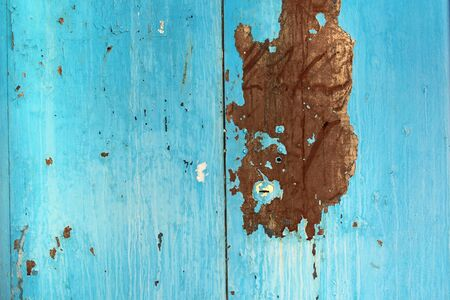 Old iron sheet with peeling blue paint and rusty spots. Texture paint and rust background for design. Reklamní fotografie