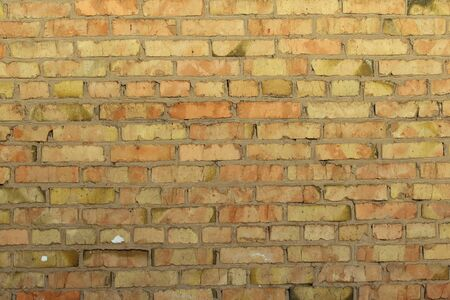 Retro brick wall old golden color texture, great design for any purposes. Gray grunge texture.
