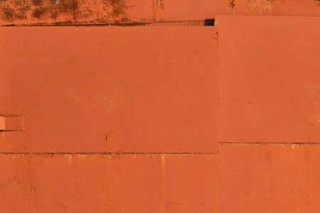 Old iron sheet with peeling brown paint and rusty spots. Texture paint and rust background for design.