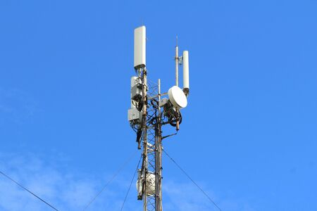 Base station mobile network antenna on a steel structure mast with a repeater. 3g, 4g, 5g.