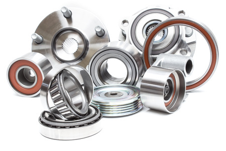 automotive industry: located on a white background variety of bearings and rollers wide range of applications, from automotive hub to engine belt tensioners