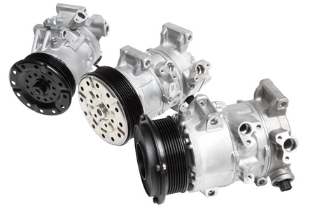 Three different air conditioning compressor for different car engines, isolated on white background