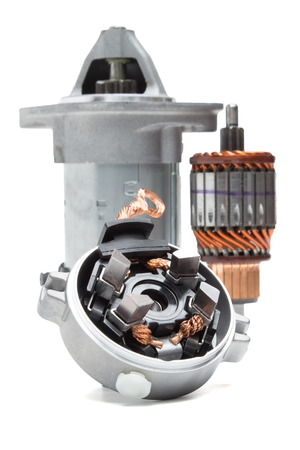 automobile starter motor and its rotor on white background
