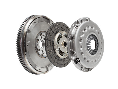 Set to replace the automobile clutch (composed of damping flywheel, drive and basket) on a white background. horizontal layout Photo Archivio Fotografico