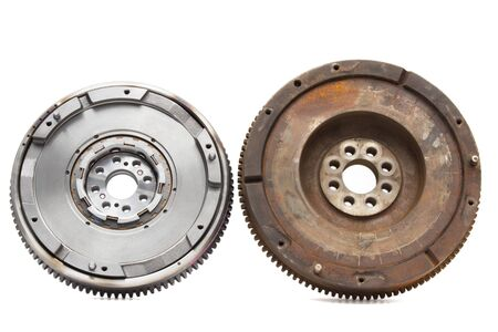 damping: new and old rusty damping flywheels for automotive diesel engines on a white background. car parts