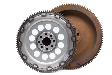 new and old rusty damping flywheels for automotive diesel engines on a white background. car parts