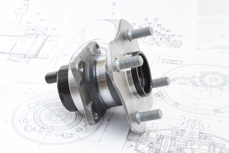 hub with bearing and ABS sensor on the background of drawings and plans Stock Photo