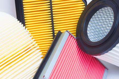 Grupo de los diversos filtros de automoción. filtro de aire, filtro de aceite, filtro de cabina, caja de cambios automática