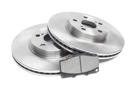 ventilated brake discs and pads on a white background