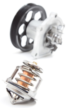 cooling system: water pump and thermostat, two elements of the engine cooling system Stock Photo