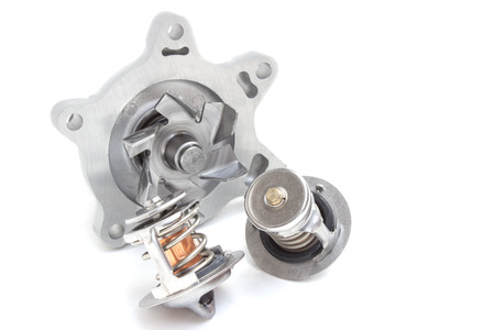 pomp: water pump and thermostat, two elements of the engine cooling system Stock Photo