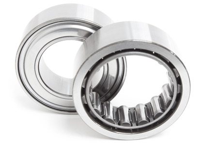 various bearings lie on a gray background