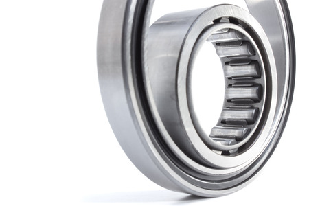 to lie: various bearings lie on a gray background