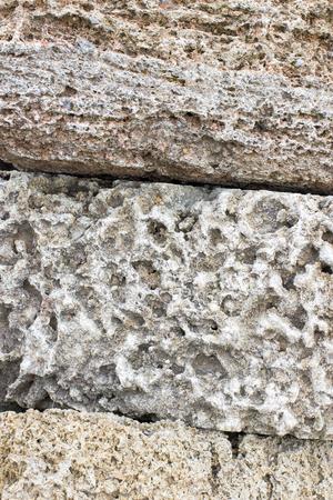 spongy: texture Rakushnjak or coquina. Bricks Stone Sand selling of fossil corals, sponges, shells, rapanov, spongy surface. horizontal shot Stock Photo