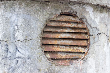 metal grate: old rusty sewer ventilation grille