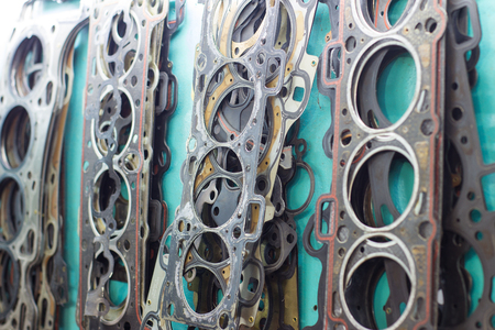 old worn head gasket on the wall hang a bundle Stock Photo