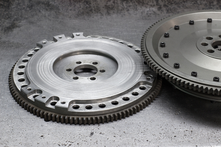 damping: Set to replace the automobile clutch (composed of damping flywheel, drive and basket) on a metal background