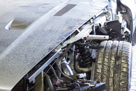 shiny car: bottom view of the chassis raised on a lift car