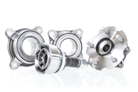 located on a white background variety of bearings and rollers wide range of applications, from automotive hub to engine belt tensioners