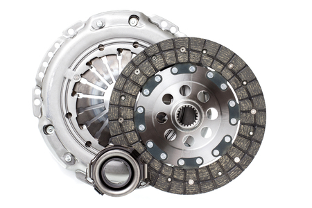 The composition of the elements of car repair kit clutch manual gearbox isolated, on a white background. Auto shop.
