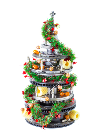 Abstract christmas tree of car parts on a white background. Decorated with Christmas toys, garland Stock Photo