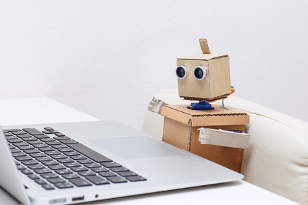 Robot and laptop keyboard Stock Photo
