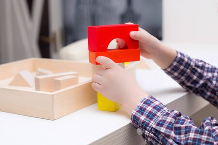 playing with wooden cubes at home, childrens games