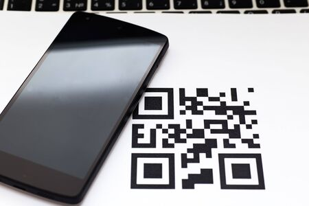 qrcode: smart phone and qr code icon