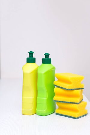 sponge and bottles of detergent for cleaning the house Stock Photo