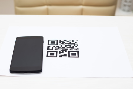 qrcode: qr-code and smartphone on the table