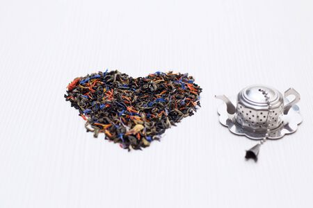 heart shape of the tea leaves Stock Photo