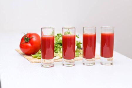 tomato juice: Four glass cups tomato juice Stock Photo