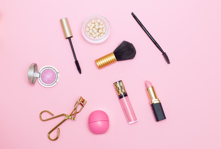 make up products pink background. Flat lay
