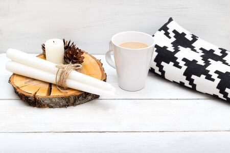 A cup of hot chocolate, a blanket, candles - items for a cozy holiday Stock Photo