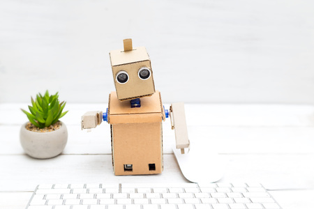Robot with hands and its desktop. Stock Photo