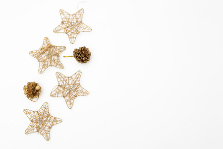 Christmas ornaments of gold color on a white background. Mockup