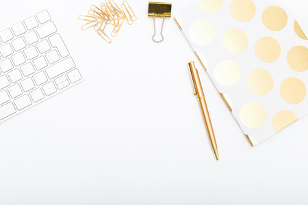 Workplace with golden objects. Copy space Stockfoto