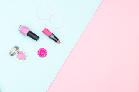 Womens Accessories and Cosmetics on pastel color background. Copy space Banco de Imagens