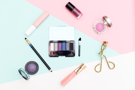 Cosmetics and accessories on pastel color background. Flat lay 스톡 콘텐츠