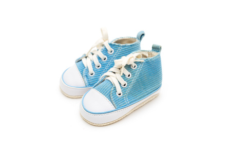 Blue sneakers for the kid on a white background. Isolated objects